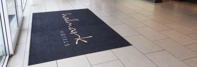 black coir mat at hotel entrance